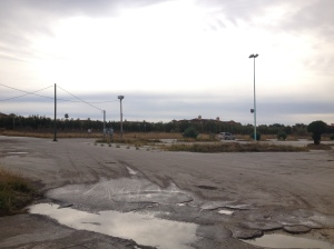 A former strip mall demolished before the project began. Plans to redevelop the tract came to a halt once road work started.